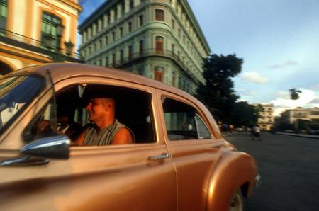 chevrolet: Old car 1950s Chevrolet passing the Saratoga Hotel, Paseo de Marti, Old Havana, Cuba