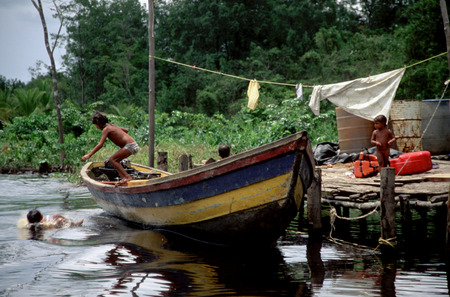 translates: A boat in the Orinoco River. The Warao are an indigenous people inhabiting northeastern Venezuela and western Guyana. Alternate common spellings of Warao are Waroa, Guarauno, Guarao, and Warrau. The term Warao translates as the boat people, after the Wa