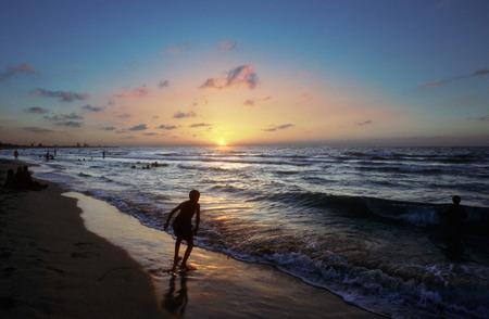 atraction: Silhouettes on Varadero Beach in Cuba at sunset