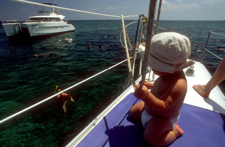 swimm: Child in Crucero del Sol, catamaran shared excursion, Varadero, Cuba. Sail off-shore and discover - swimming or snorkeling - the beautiful, crystal-clear waters surrounding the Cuban peninsula.  Cayo Blanco is next on the itinerary, where you'll enjoy a