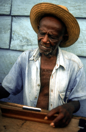 atraction: Old man playing dominos on street in Trinidad, Cuba, West Indies, Central America.
