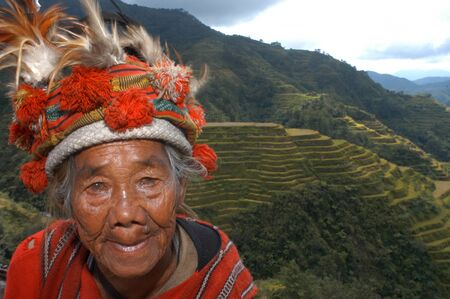Women of the Ifugao tribe. Rice terraces. View point. Banaue. Northern Luzon. Philippines. Banaue (or alternatively spelled as Banawe) is a fourth class municipality in the province of Ifugao, Philippines. According to the 2010 census, it has a population