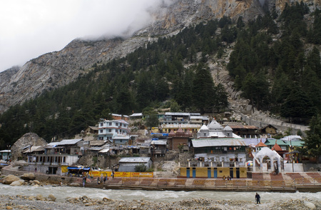 hinduist: River Bhagirathi and Gangotri Temple and houses; Uttaranchal ; India. Gangotri, Uttaranchal, India. Gangotri, the source of the Ganga (Ganges) River and seat of the goddess Ganga, is one of the four sites in Indias Char Dham pilgrimage. Gangotri can be r