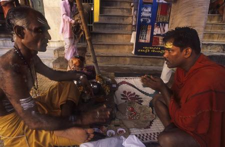 renounce: Devote pray wirh a guru Sadhu, Varanasi, Uttar Pradesh, India. Varanasi, Uttar Pradesh, India. Varanasi sadhu. In addition to hosting religious festivals, Varanasi is home to a large concentration of sadhus. Sadhus are Hindu monks who renounce most sensua