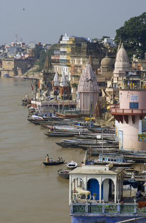 relieved: Ghats on the banks of Ganges river in holy city of Varanasi. Varanasi, Uttar Pradesh, India. Varanasi Ghats are perhaps the most holiest place in the world, where one is relieved from all the worldly responsibilities and one enters into a domain that is d