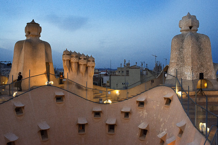 s and m: Casa Mila, La Pedrera, skyline of Barcelona, Spain. The chimneys. Panorama of the roof at dusk, evening, night. Unesco Heritage. Even if architecture isn't your thing, Gaudí's trippy Casa Milà (or La Pedrera, the quarry) on Passeig de Gràcia is a m Editorial