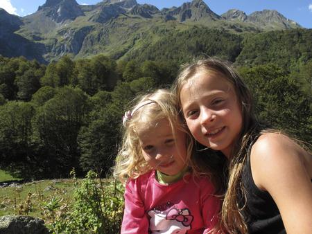 aran: Girls in a landscape near the tunnel of Vielha, road N 230, Vielha e Mijaran, Viella, Val dAran, Aran Valley, Pyrenees, Lleida province. View of mountains, town centre, river and Vielha small lake Editorial