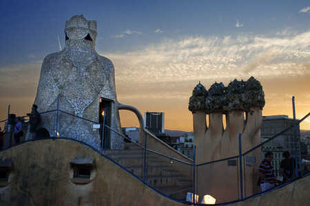 CIA: Casa Mila, La Pedrera, skyline of Barcelona, Spain. The chimneys. Panorama of the roof at dusk, evening, night. Unesco Heritage. Even if architecture isn't your thing, Gaudí's trippy Casa Milà (or La Pedrera, the quarry) on Passeig de Gràcia is a m Editorial
