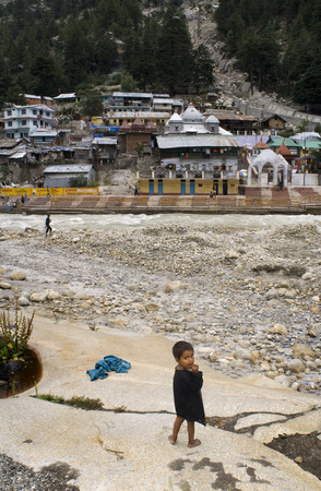 hinduist: River Bhagirathi and Gangotri Temple and houses; Uttaranchal ; India. Gangotri is the origin of River Ganga and one of the four sites in the Chardham Yatra. Here, Ganga is known as Bhagirathi, named after the ancient king Bhagirath, who performed penance