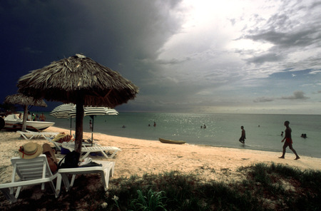 atraction: Transparent water and white sandy beach, Cayo Jutias, Cuba. Swimming in the tropical water at Cayo Jutias, Cuba.