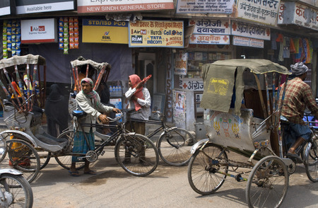 uttar pradesh: Traffic, Old City, Varanasi, Uttar Pradesh, India, Asia. Varanasi, Uttar Pradesh, India. Varanasi is the most chaotic city I have ever seen. Cows, bicycle rickshaws, autorickshaws, a bull, overflowing street markets and the occasional monkey all fight for