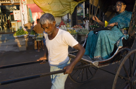 banning the symbol: Kolkata, West Bengal, India. Last Days of the Rickshaw. Kolkata is bent on burnishing its modern image—and banning a potent symbol of India's colonial past. The strategy of drivers in Kolkata—drivers of private cars and taxis and buses and the enclo