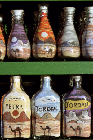 scenaries: Sand-filled bottles to sell as souvenirs, Petra, Jordan. Colorful Sandbottles, a typical souvenir from Jordan, displayed in a shop at the entrance of Petra. Editorial