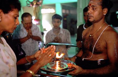 fareast: People praying in Sri Mariamman Temple in Little India in George Town in Penang Island in Malaysia.