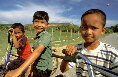 langkawi island: Happy children on a bicycle on Langkawi Island on Malaysia Editorial