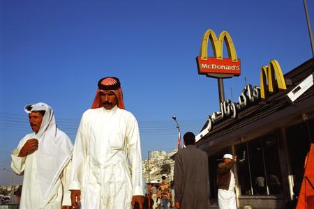 mc: Fast Food chain, branch restaurant of Mc Donalds in Amman, Jordan. American capitalism against classical Muslim society