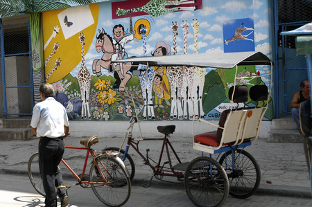Bicycle taxi and street art, Habana Vieja (Old Havana), Cuba.