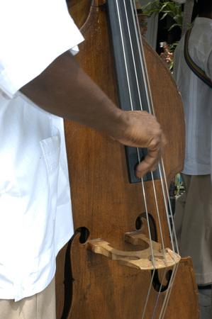bass player: Street music in Old Habana, Cuba, West Indies, Central America. Double Bass Player Havana Cuba Caribbean Stock Photo