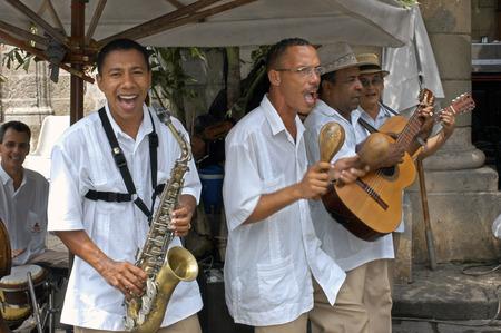 quintet: Musicians Play Cuban Rhythms on the Streets of Havana. Music, Old Habana, Cuba. Music band playing outside a restaurant, Havana (Habana), Cuba, Caribbean.
