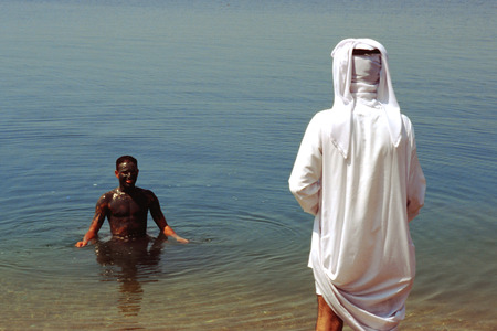scenaries: People covered with mud and swimming at the dead sea, Jordan Stock Photo