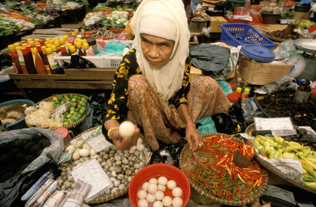 Kelantan State, Kota Bharu, Women selling fruit and vegetables in the towns central market, Malaysia. Editorial