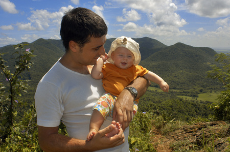 Father with her doughter. Sweeping view of Valle de Vinales, Cuba