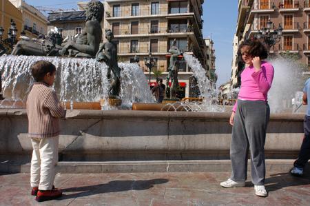 Neptuno fountain in Plaza de la Virgen , modern fountain representing River Turia & 8 irrigation channels into agricultural area, Valencia, Spain.
