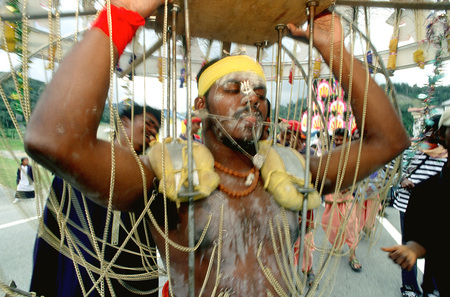stereotypically: Hindus taking part in Thaipusam, during a pilgrimage to the Batu Caves north of Kuala Lumpur in Malaysaia.