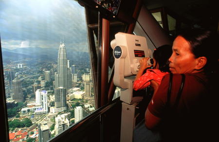 View of the city from Menara TV Tower, fourth largest telecommunications tower in the world, Kuala Lumpur, Malaysia. Petronas Twin Towers, view from Menara tower. Editorial