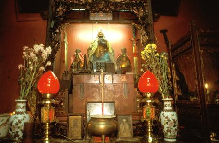 Burning incense in Chinese temple, Melaka, Malaysia.