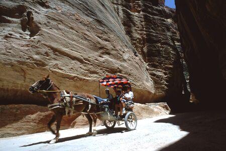 Horse carriage going through the Siq, Petra, Jordan Banco de Imagens