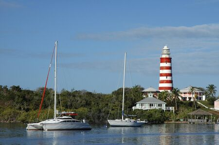 Hope Town lighthouse, Elbow Cay, Abacos. Bahamas. Lighthouse and harbor in the tiny village of Hope Town. Editorial