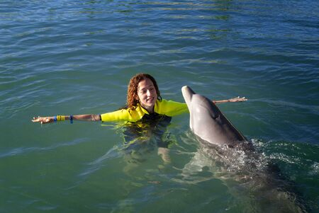 Sanctuary Bay, Grand Bahama. Bahamas. UNEXSO. Program Swim and close encounter with the dolphins.