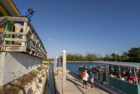 Sanctuary Bay, Grand Bahama. Bahamas. UNEXSO. Tourists. Program Swim and close encounter with the dolphins. Editorial