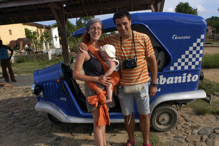 Caucasian family of tourist in a Cubanito, typical tuc-tuc transport in Trinidad, Cuba.