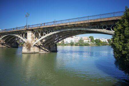 Seville river, view of the Punte de Isabel II (Triana) bridge spanning the Rio Guadalquivir in Seville - Sevilla Banco de Imagens