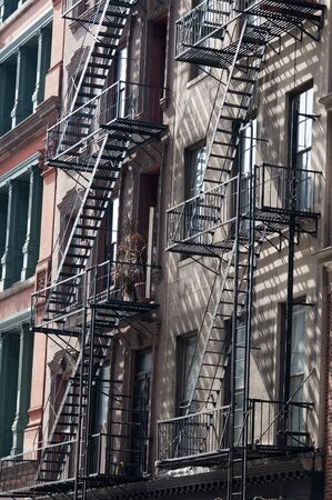 Fire Escape, Tribeca, Manhattan, New York City, New York. A fire escape is a special kind of emergency exit, usually mounted to the outside of a building or occasionally inside but separate from the main areas of the building. Foto de archivo - 144570960