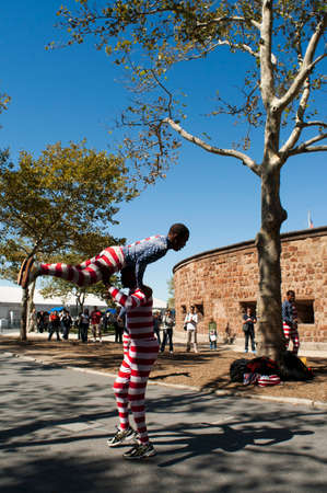 Artists dressed of american flag. Battery Park City. A large green area with a promenade along the Hudson River, beginning at the southern tip of Tribeca, in Rockefeller Park and extends to the Ferry Terminal on Staten Island, sharing the stage with moder Editorial