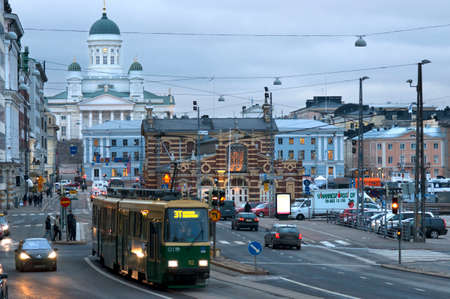 General view of the Helsinki city with the tram, market, and the Senaatintori Lutheran Cathedral from the Eteläranta street. Editorial