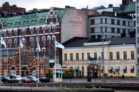 Outside The Old Market Hall Hietalahden Kauppahalli  with an extensive range of exotic local Finnish foods and products Helsinki Harbour Finland Editorial