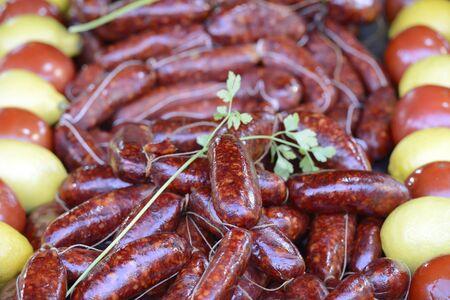 Fair, chorizo (sausage) with tomatoes and lemon