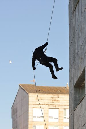 anti social: Club of stuntmen shows to people of the city a simulation of training of police special forces in Vilagarcia de Arousa, Galicia, Spain. June 16, 2014.