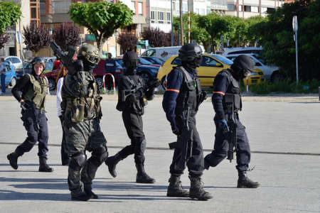 swat teams: Club of stuntmen shows to people of the city a simulation of training of police special forces in Vilagarcia de Arousa, Galicia, Spain. June 15, 2013.