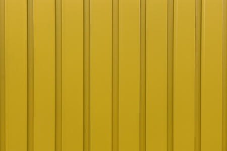 image of yellow plastic surface closeup background