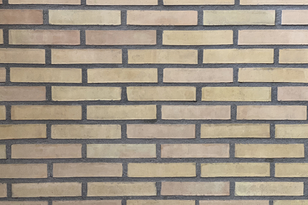 image of yellow brick wall closeup background