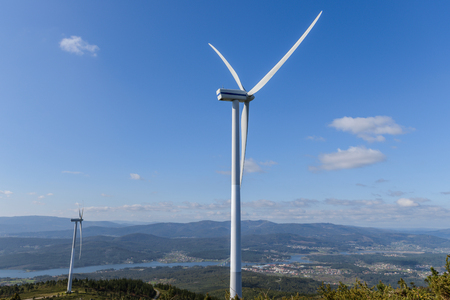 image of wind turbine against a blue sky
