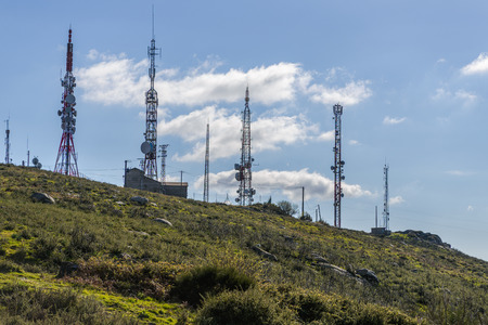 image of cellular antennas against a blue sky