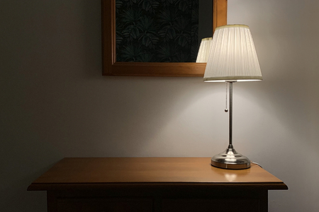 image of table lamp with lampshade on a wooden table