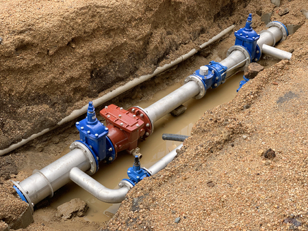 image of new water pipe in the ground Stock Photo