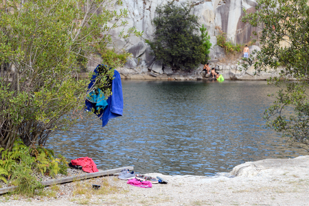 image of clothes of people swimming at the lake